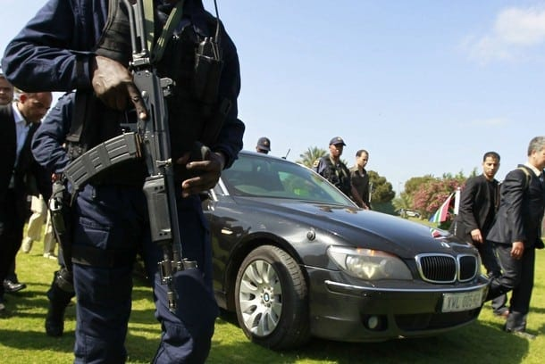 Bodyguards surround the car of South African President Jacob Zuma upon his arrival at an area in Bab al-Aziziyah compound in Tripoli May 30, 2011. Libyan state television on Monday broadcast footage of Muammar Gaddafi greeting visiting Zuma, the first time the Libyan leader has been seen in public since May 11.  REUTERS/Louafi Larbi (LIBYA - Tags: POLITICS CONFLICT IMAGES OF THE DAY)